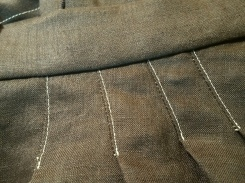 Close-up of pleats and waistband